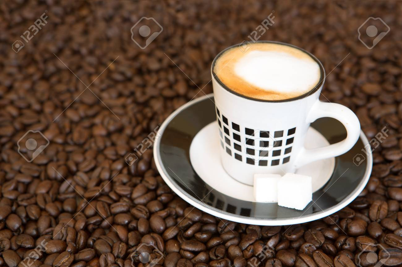Single small espresso coffee cup on roasted coffee beans background - 97431640