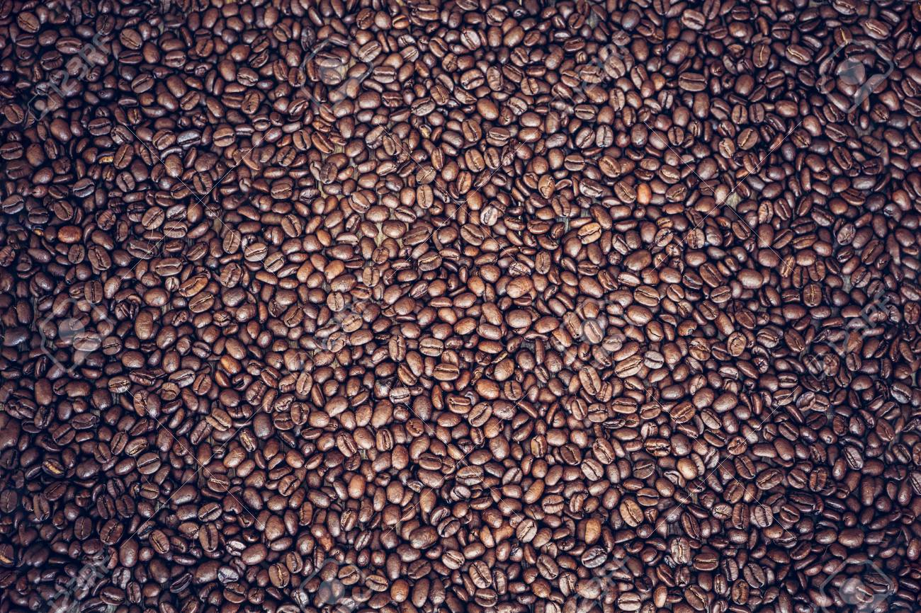 Rich brown roasted coffee beans background - 97431654