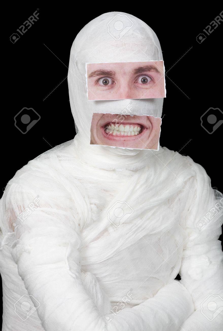 Bandaged man with false paper face on black Stock Photo - 4403758