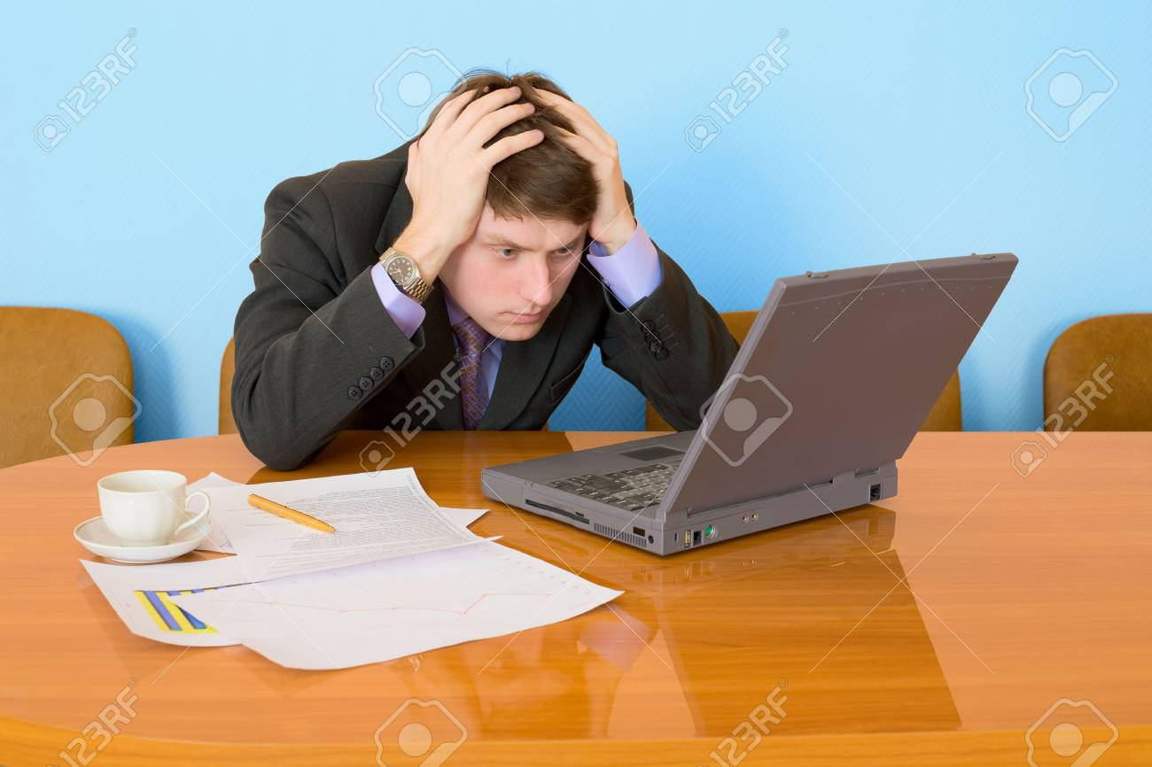 Businessman on a workplace with the laptop and a coffee cup Stock Photo - 4715438