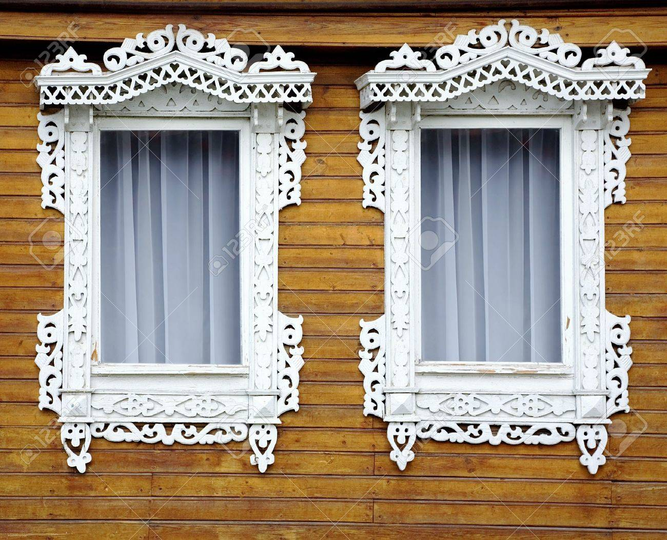 Two windows from old wooden yellow wall of house Stock Photo - 5146035