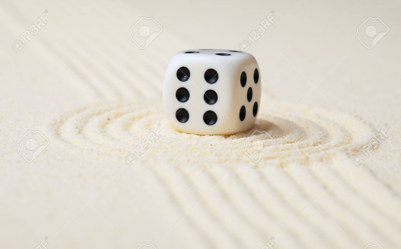 Playing dice on sand in Japanese rock garden Stock Photo - 6051399