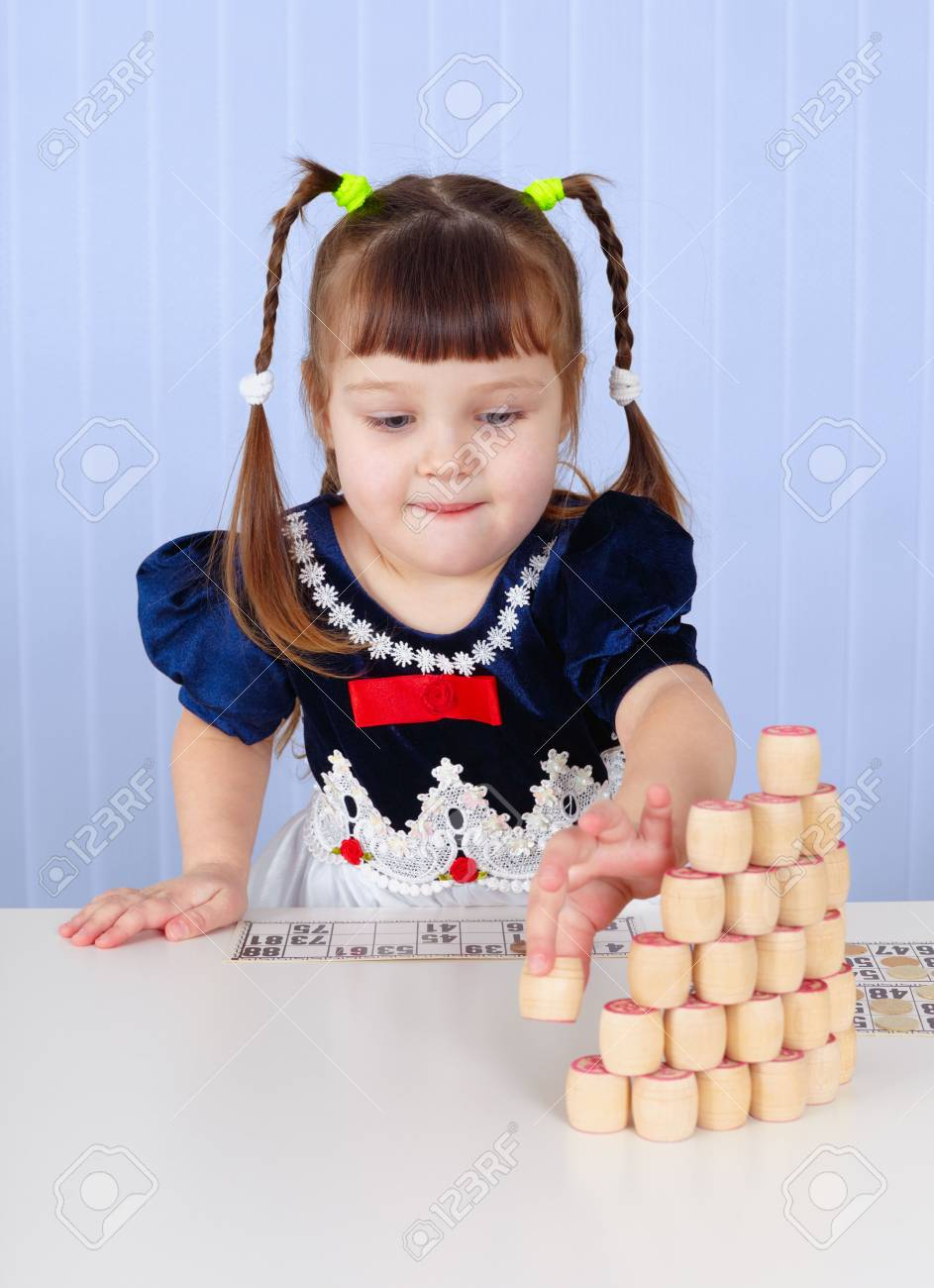 Little girl playing with toys on the table Stock Photo - 6470929