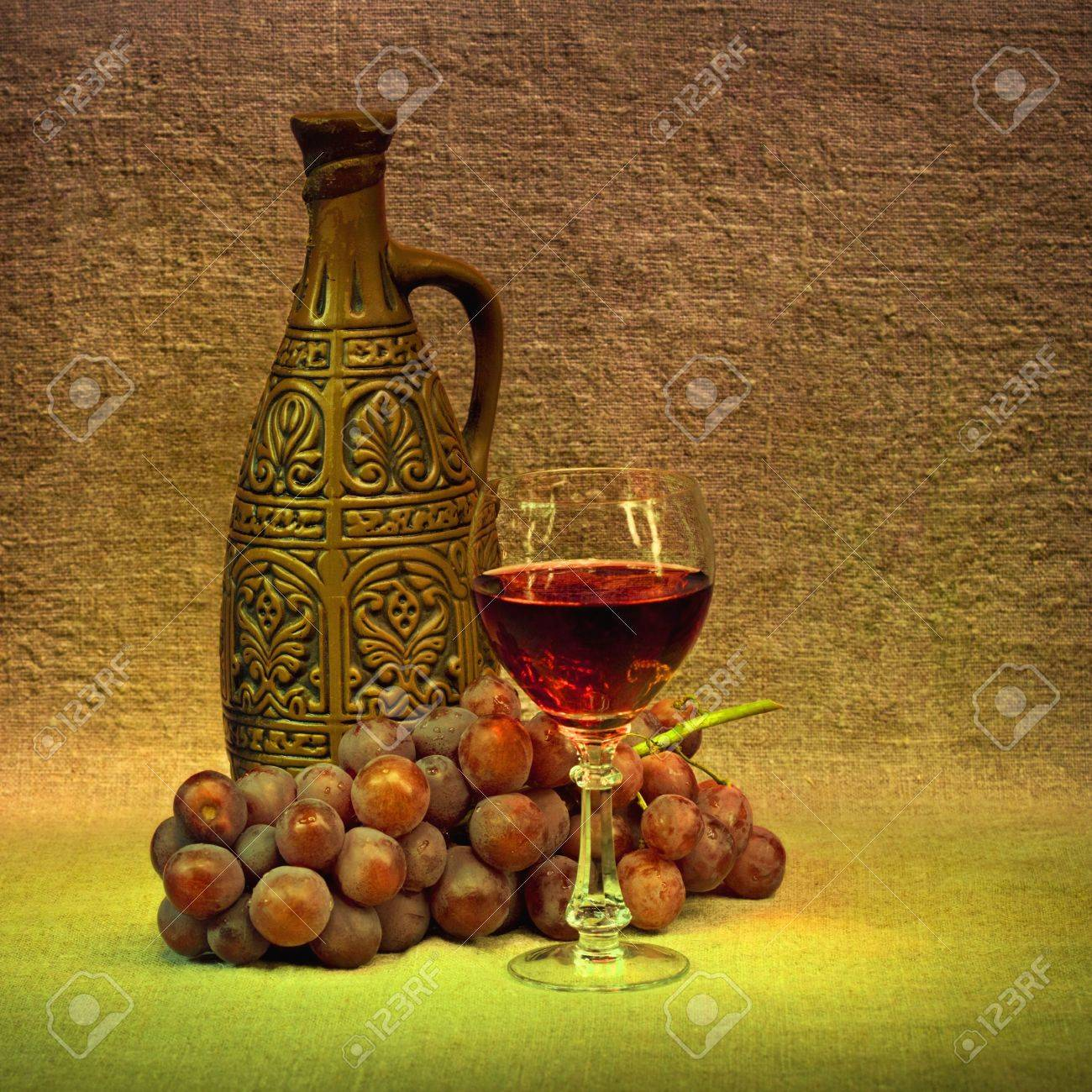 Clay bottle, glass and grapes Stock Photo - 6781407