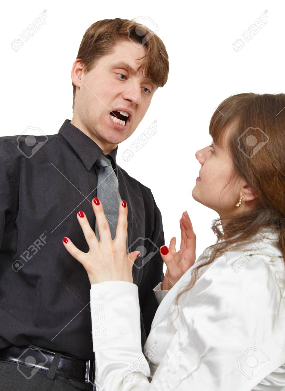 The man terribly shouts at the young woman is isolated on a white background Stock Photo - 7031626