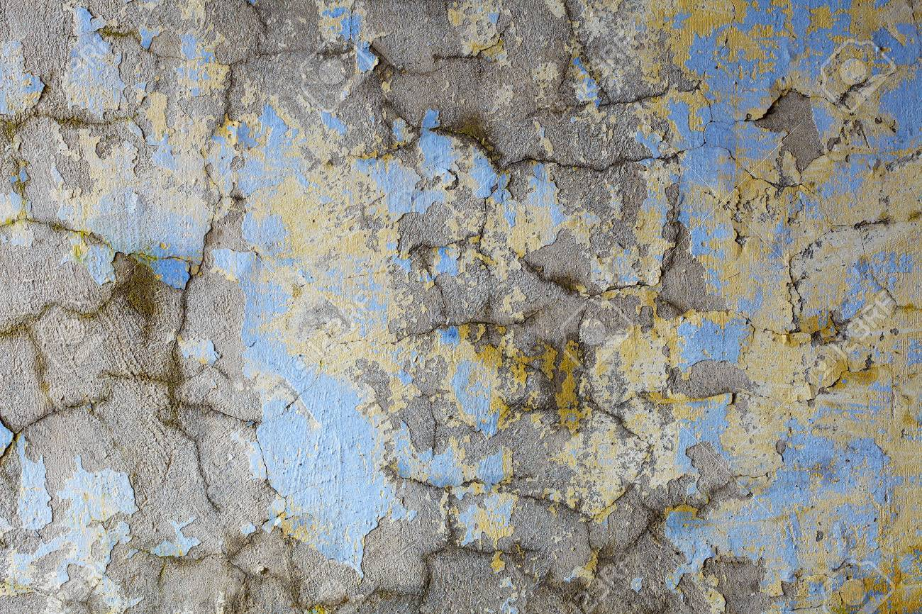 Dirty old wall covered with cracks and paint flakes Stock Photo - 7326651