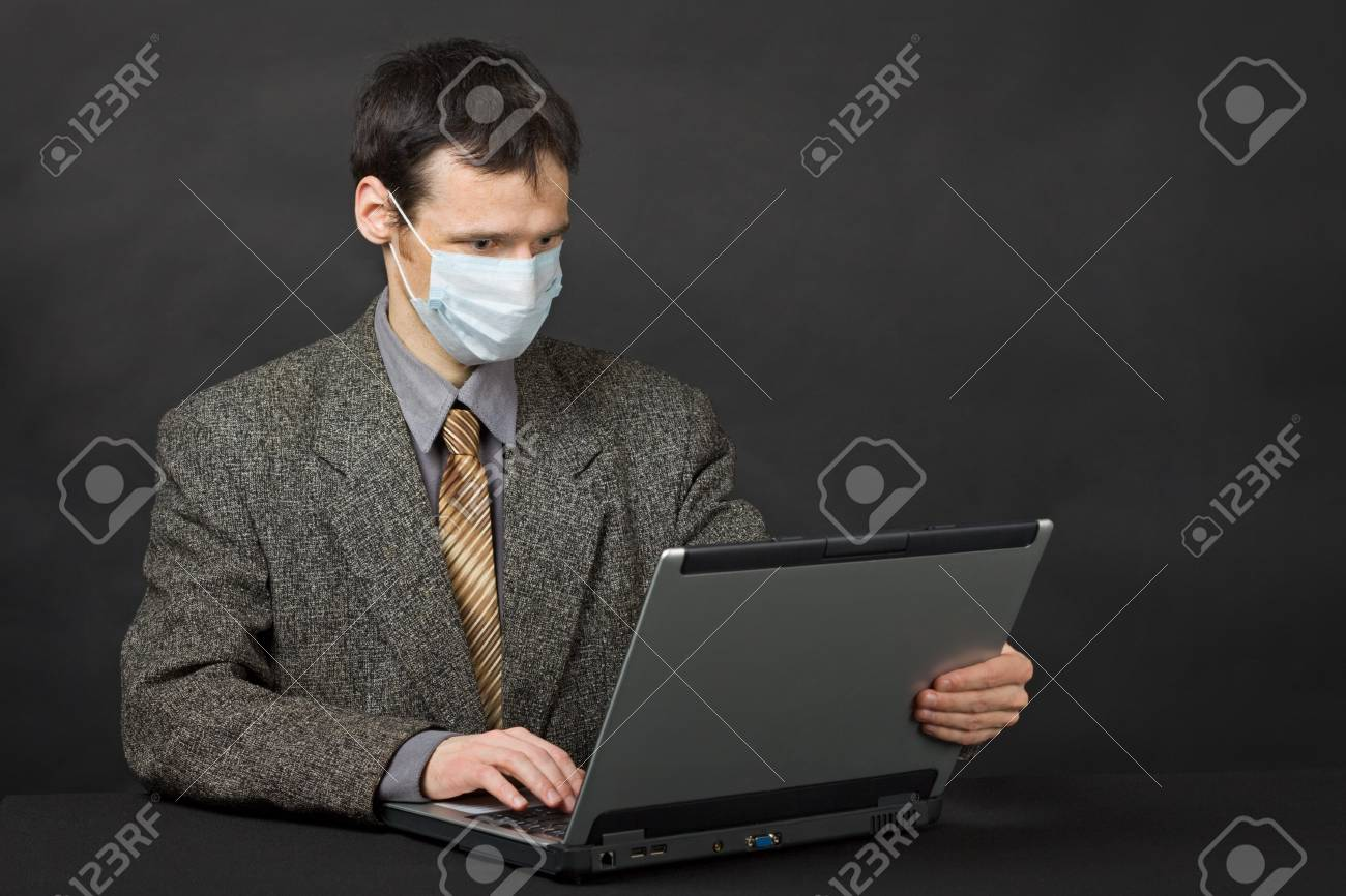 Person protected medical mask when working in Internet Stock Photo - 7530855