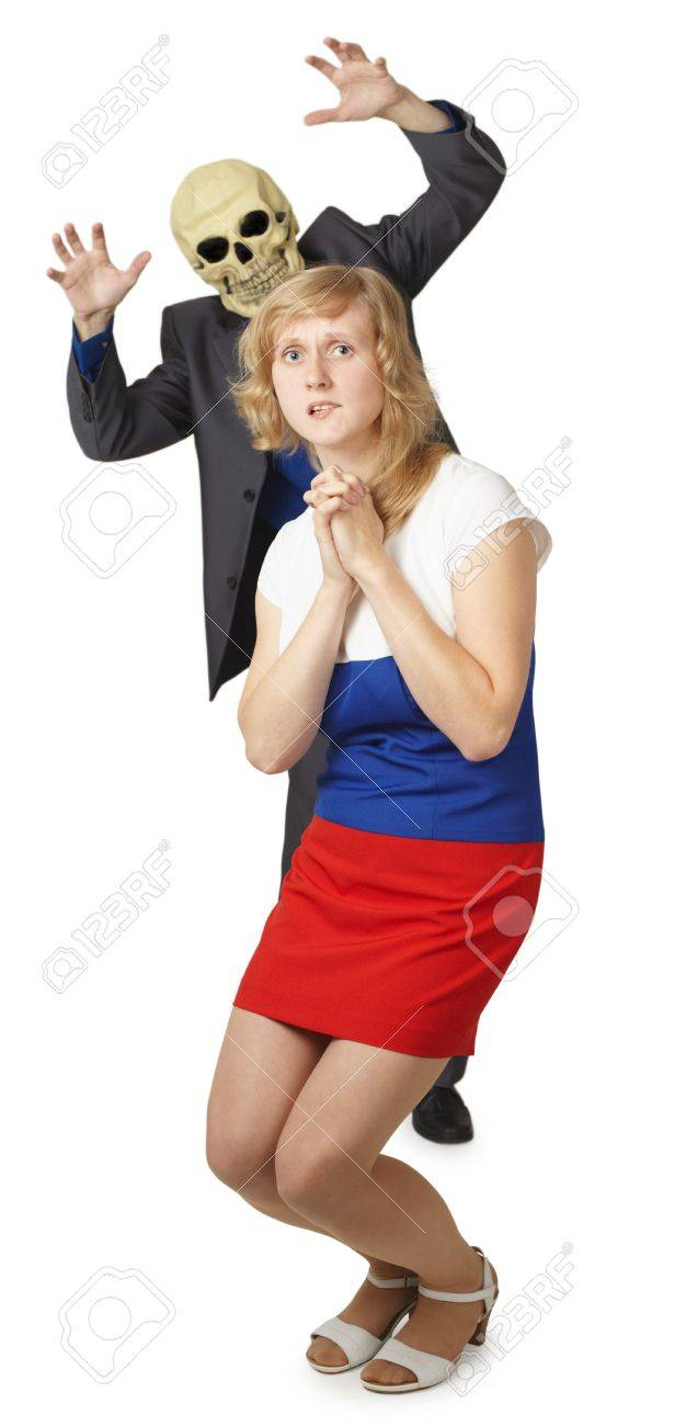 Idiot in a mask skeleton scares a young woman Stock Photo - 8205087