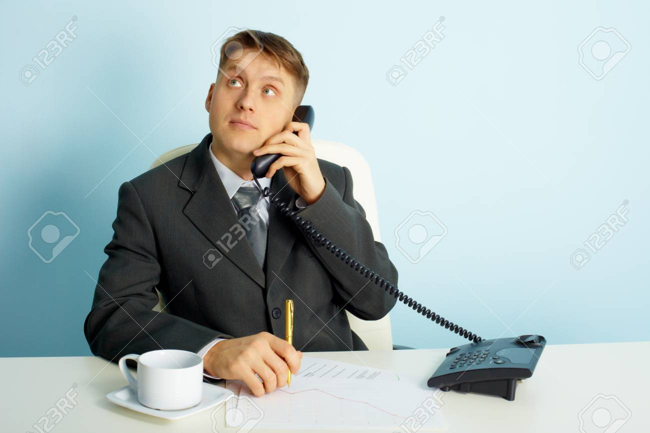 thoughtful young man with a telephone in the office Stock Photo - 8850427