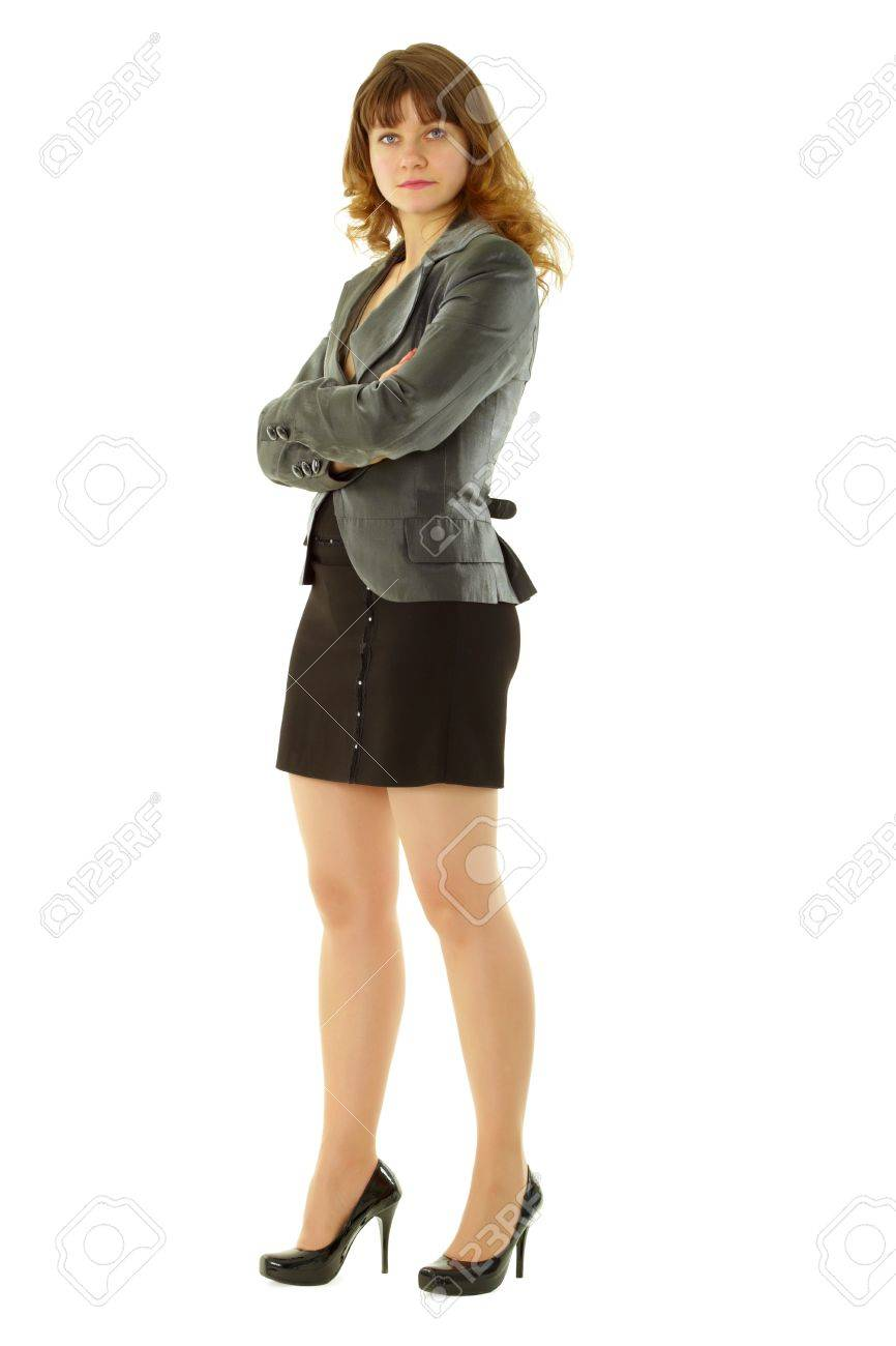 attractive girl in a short black skirt in a confident pose standing on white background Stock Photo - 8850398