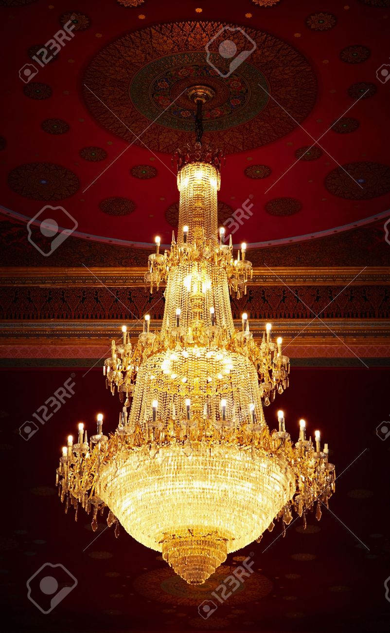 Stock Photo - The huge old antique chandelier from the ceiling of a  Buddhist temple - The Huge Old Antique Chandelier From The Ceiling Of A Buddhist