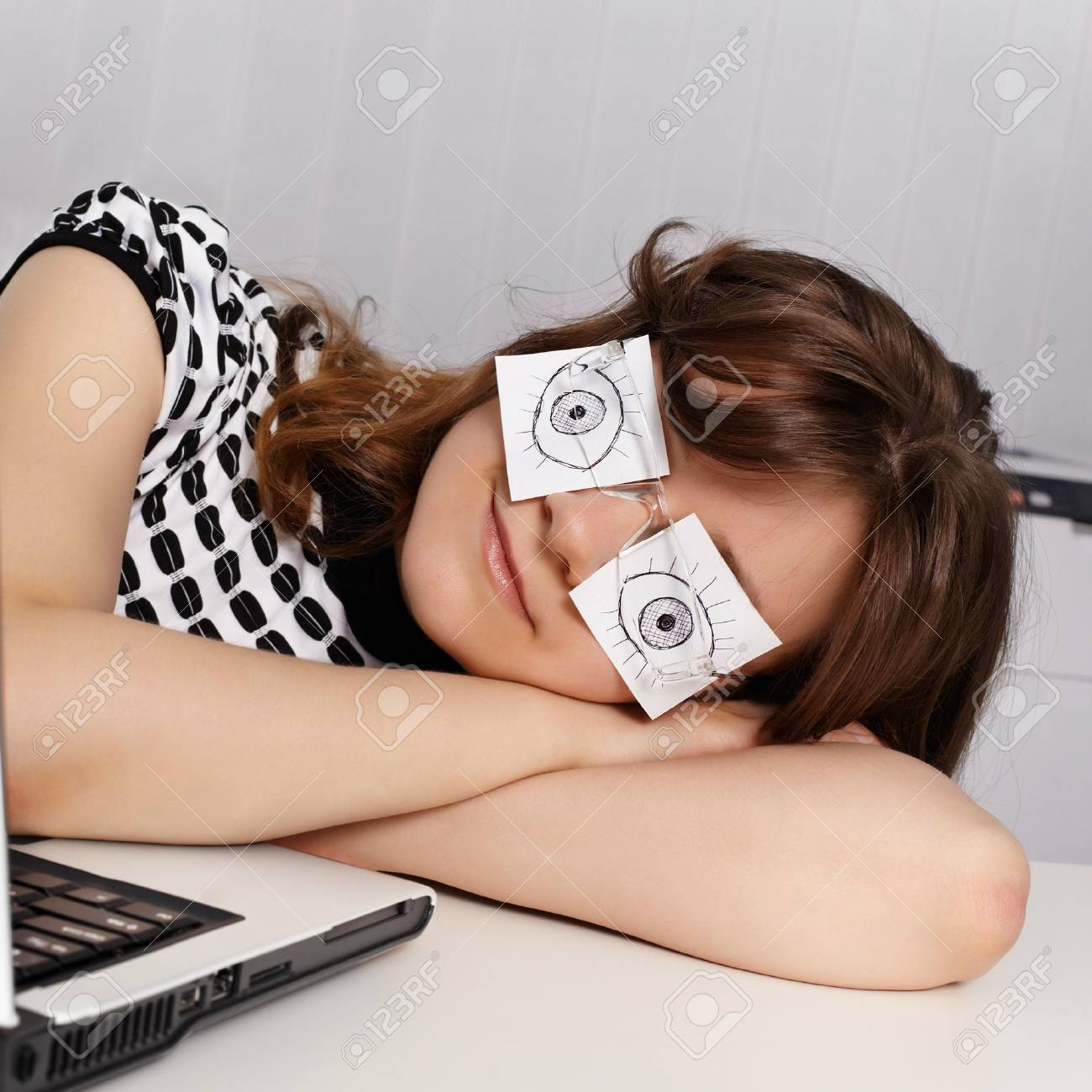 A young woman sleeps in the office during working hours Stock Photo - 11438846