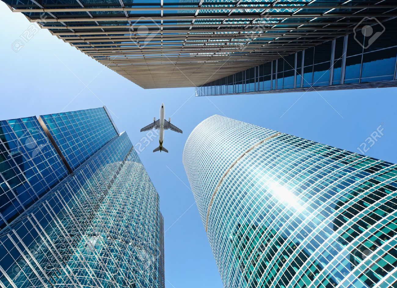 Airliner flying over high-rise buildings - skyscrapers Stock Photo - 12295161