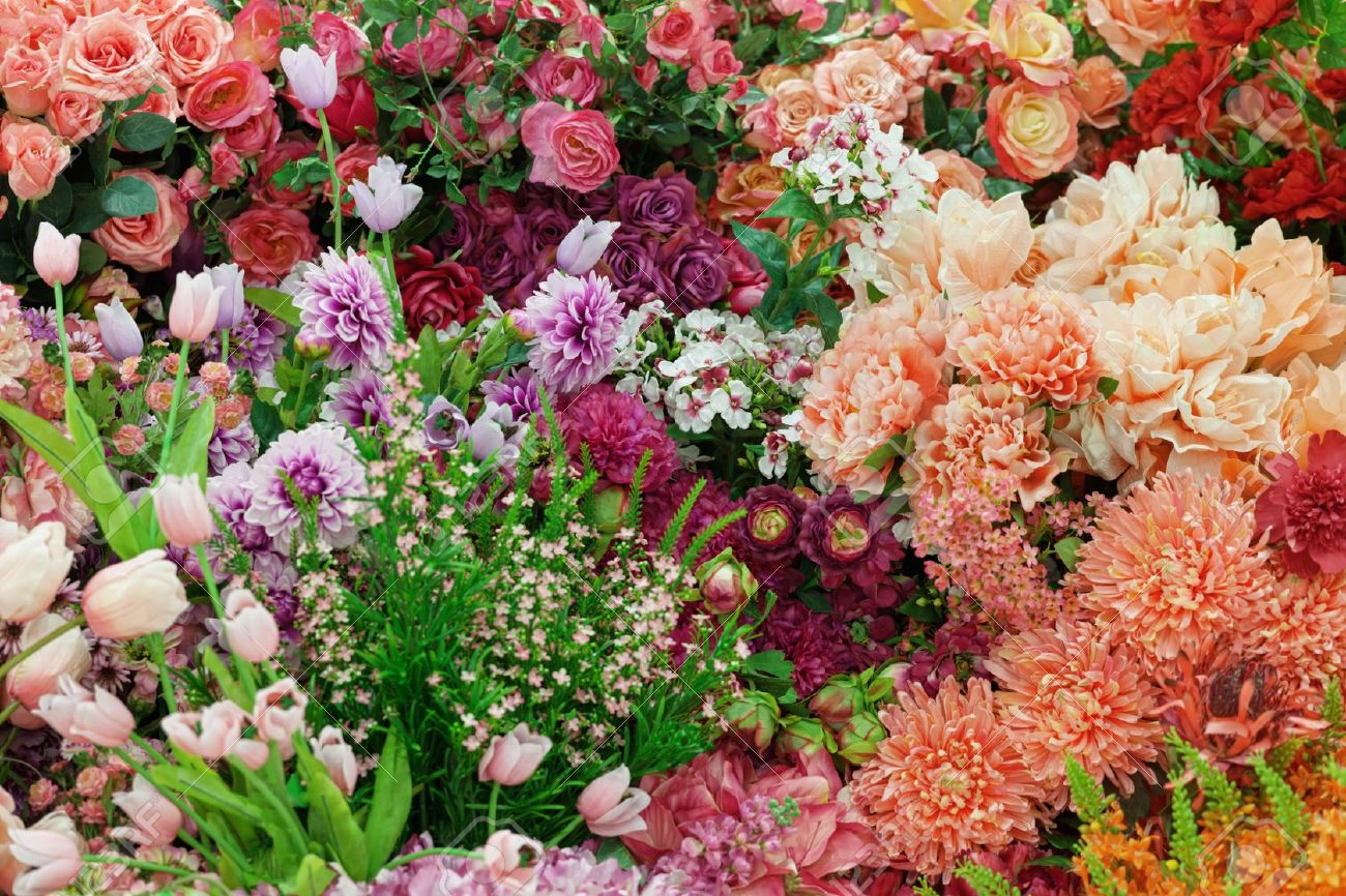 Background From A Variety Of Artificial Flowers Stock Photo