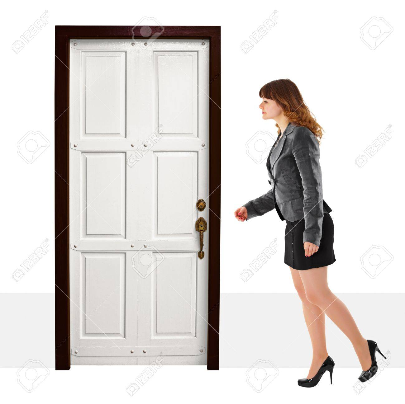 A young woman walks into door on white background Stock Photo - 12595069
