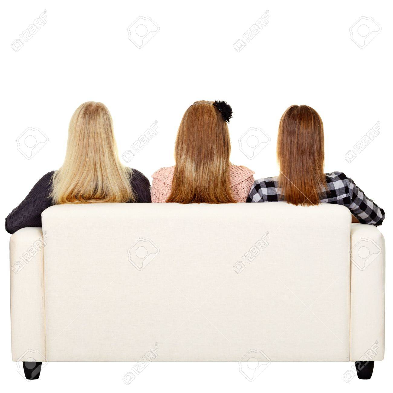 Young women sitting on sofa - rear view. Isolated on white Stock Photo - 14234218