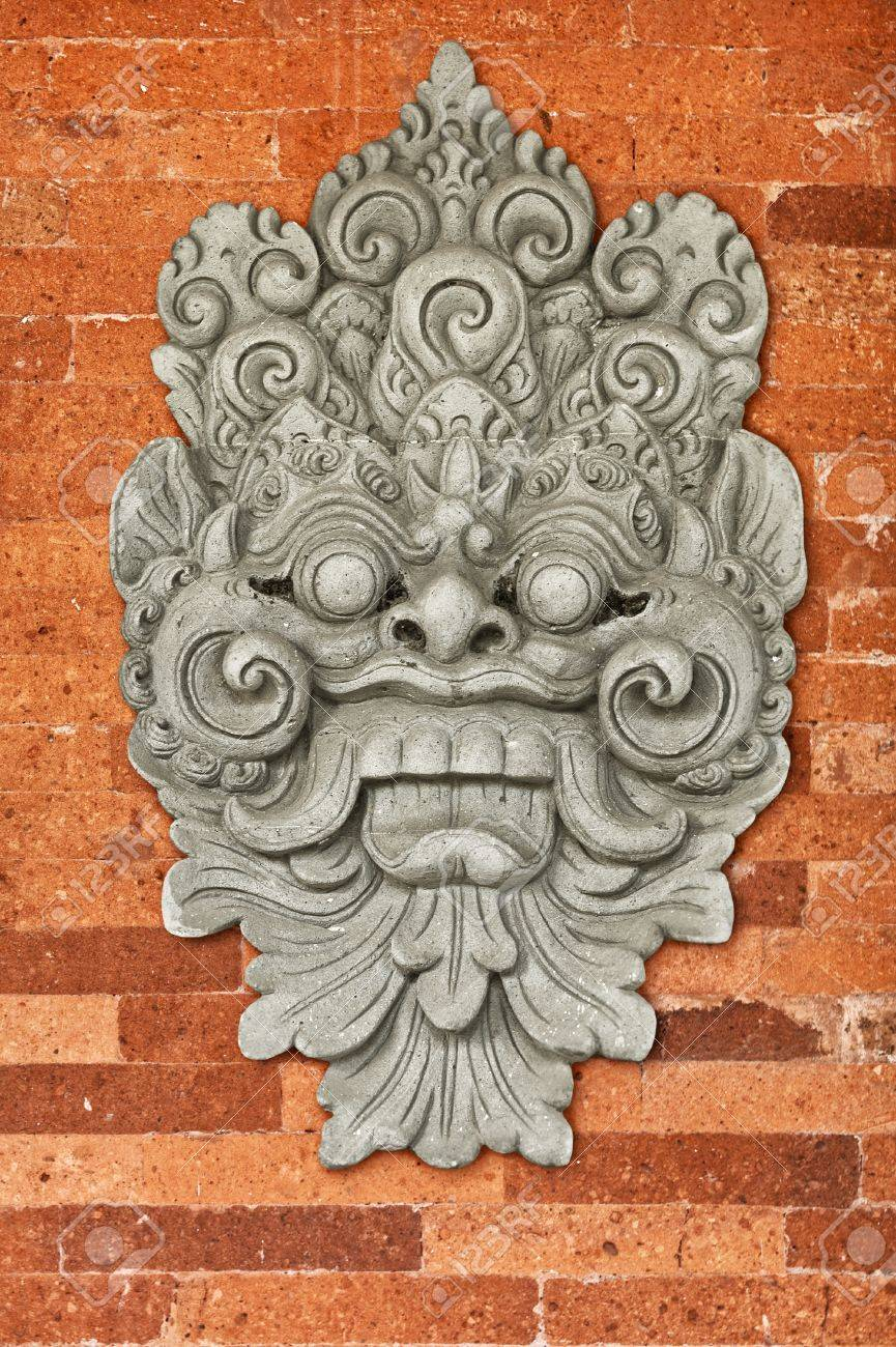 Stone bas-relief on the brick wall of the old church. Indonesia, Bali. Stock Photo - 17235638
