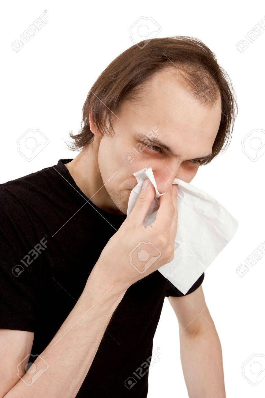 The man sneezes in a white paper handkerchief Stock Photo - 5213676