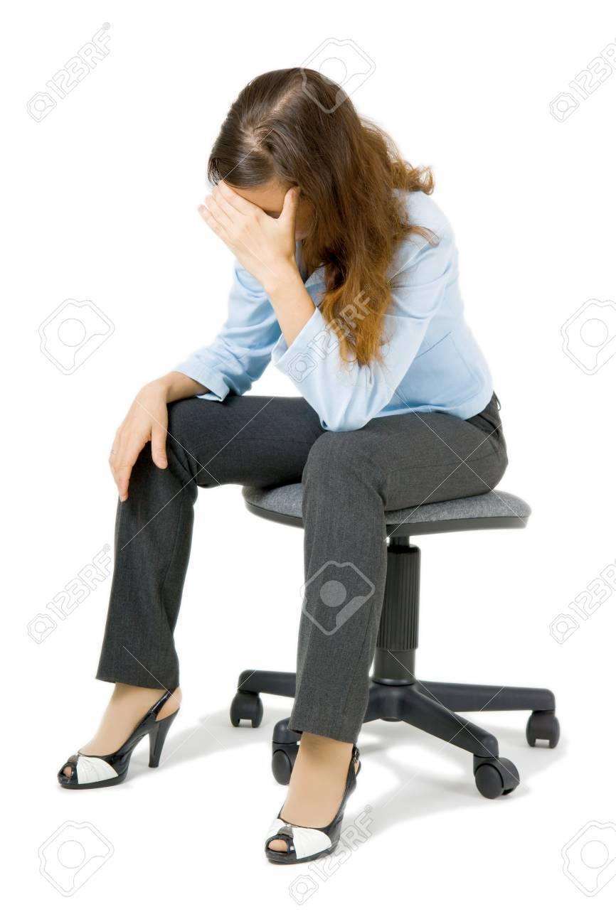 young girl sitting on a chair arm covering her face Stock Photo - 7850656