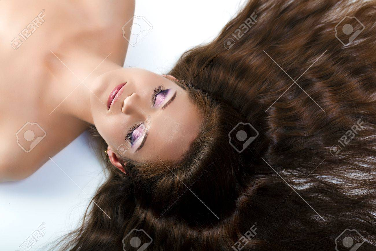 beautiful girl with long hair and make-up with closed eyes lying on the floor Stock Photo - 16656628