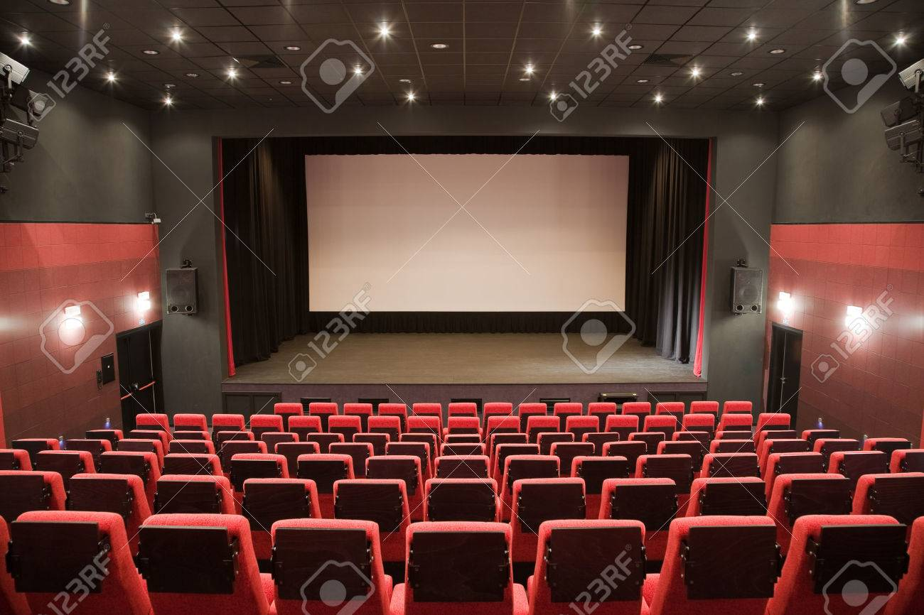 Charmant Empty Cinema Auditorium With Line Of Red Chairs,