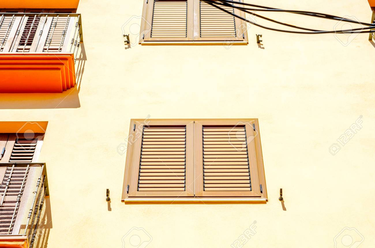 european style windows country style stock photo window shutters on an old european style building architectural decoration windows vintage style protective element of window shutters on an old european style building architectural