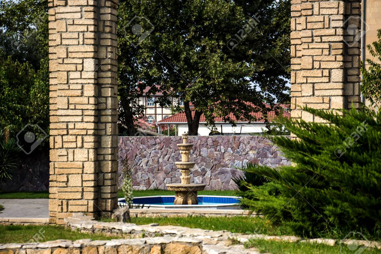 Stock photo water fountain from marble outdoor fountains from gold magic fountain park golden garden fountains in park baku beautiful black and gold