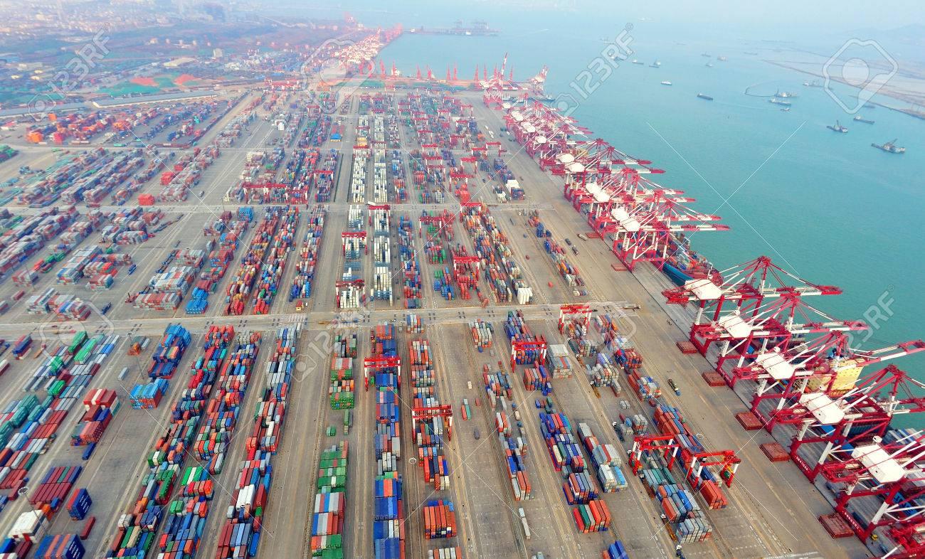 https://previews.123rf.com/images/qdxjw/qdxjw1311/qdxjw131100032/23372891-China-Qingdao-Port-Container-Terminal-Stock-Photo.jpg