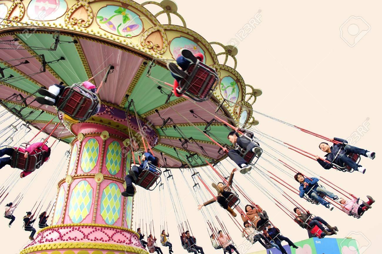 CHENGDU - FEB 3: Happy people play in the amusement park on Feb 3, 2011 in Chengdu, China. Stock Photo - 9272420