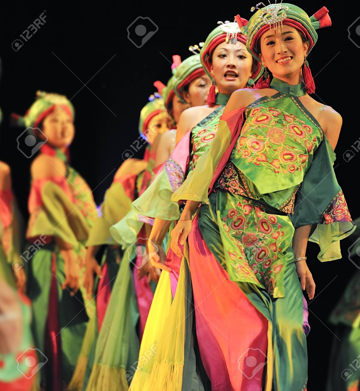 CHENGDU - SEP 28: chinese Qiang ethnic dancers perform on stage at Sichuan experimental theater.Sep 28,2010 in Chengdu, China. Stock Photo - 9397015
