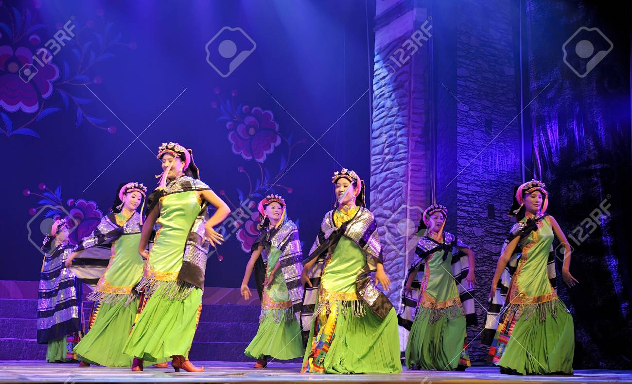 CHENGDU - SEP 27: chinese Tibetan ethnic dancers perform on stage at experimental theater.Sep 27,2010 in Chengdu, China. Stock Photo - 9411039