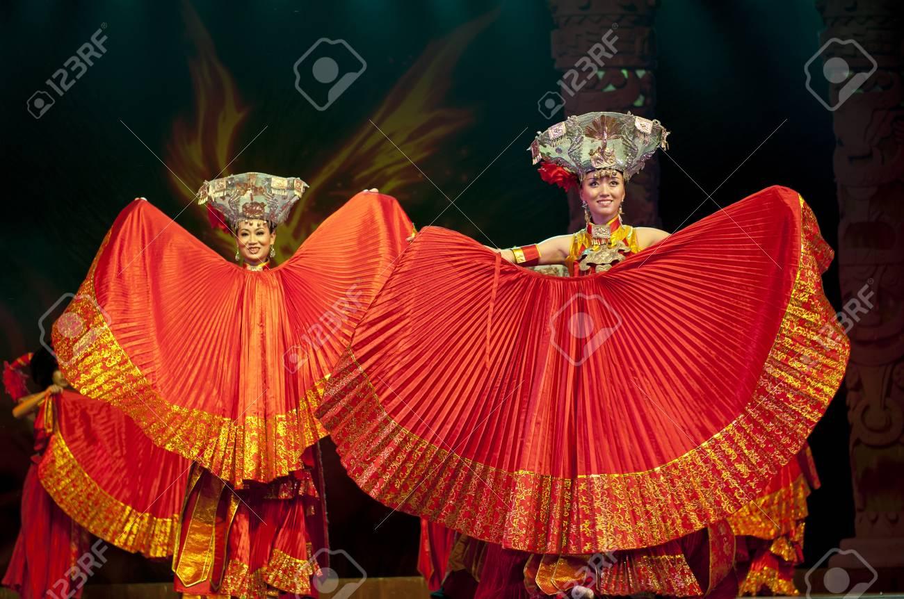 CHENGDU - SEP 26: chinese Yi ethnic dancers perform on stage at JIAOZI theater.Sep 26,2010 in Chengdu, China. Stock Photo - 10753314