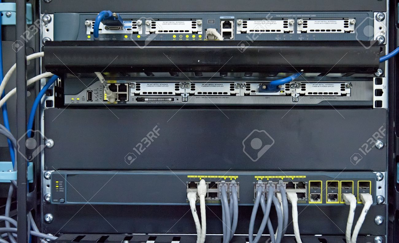 Charmant Network Hub And Patch Cables In Network Cabinet Stock Photo   11515540