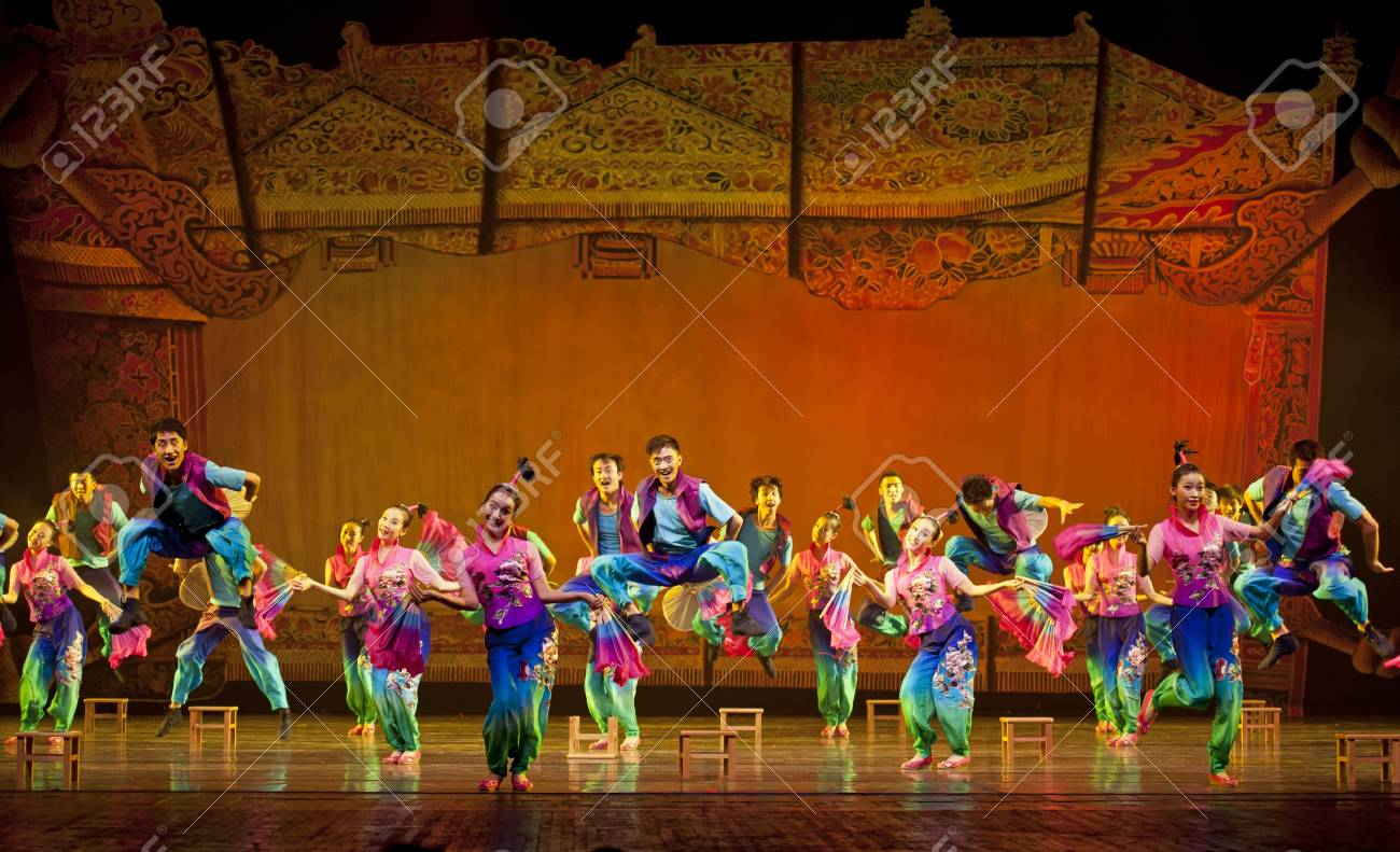 CHENGDU - OCT 18: Chinese national dancers perform folk dance on stage at JINCHENG theater on Oct 18, 2011 in Chengdu, China. Stock Photo - 13692316