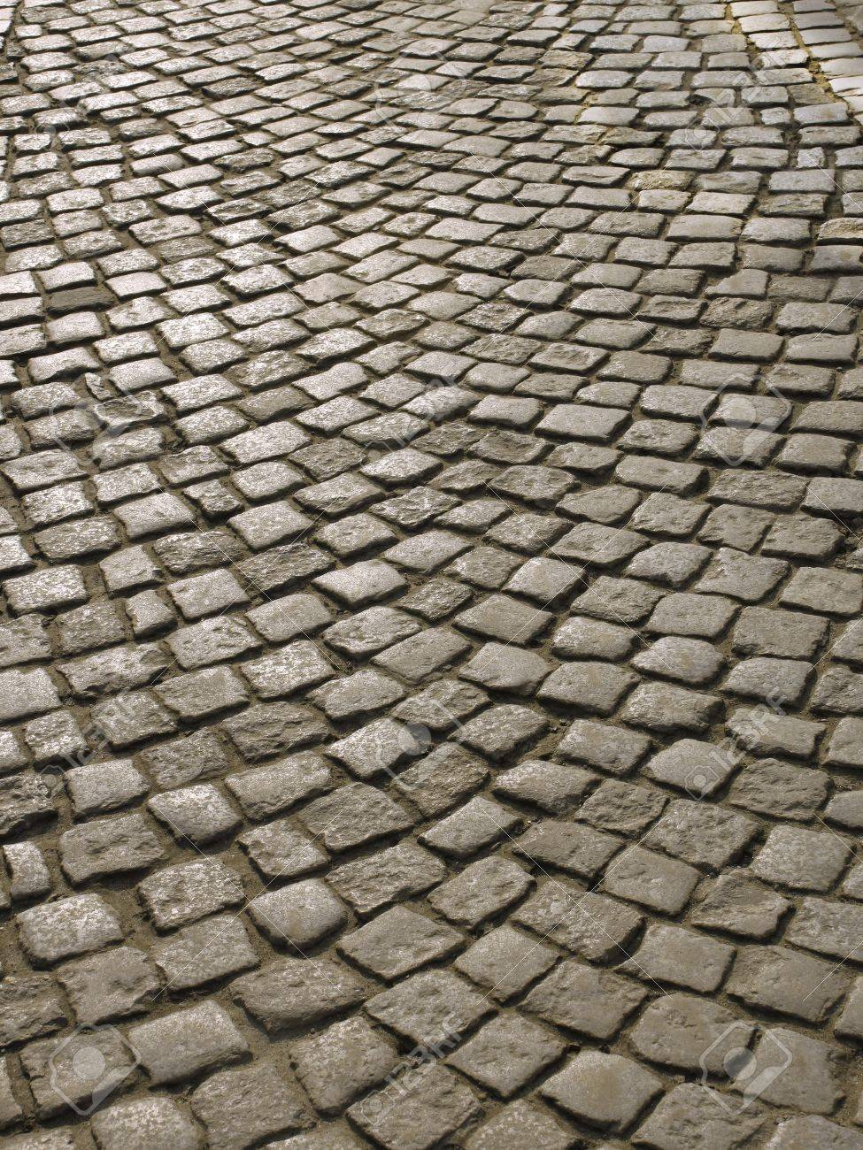 Part of urban square covered with cobblestone. Sunlight reflected on the stones Stock Photo - 9192206