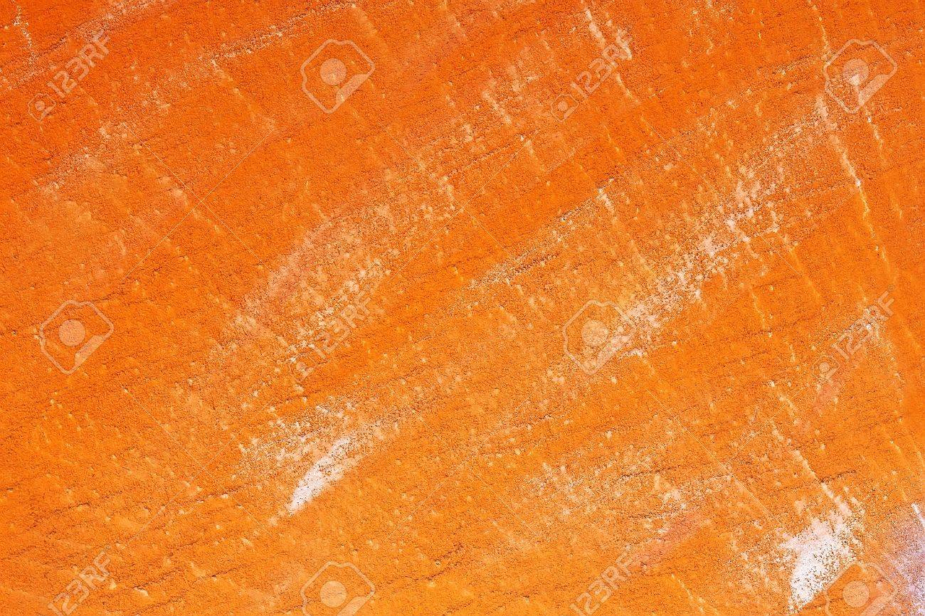 Bright Orange Paint concrete wall covered with bright orange paint stock photo