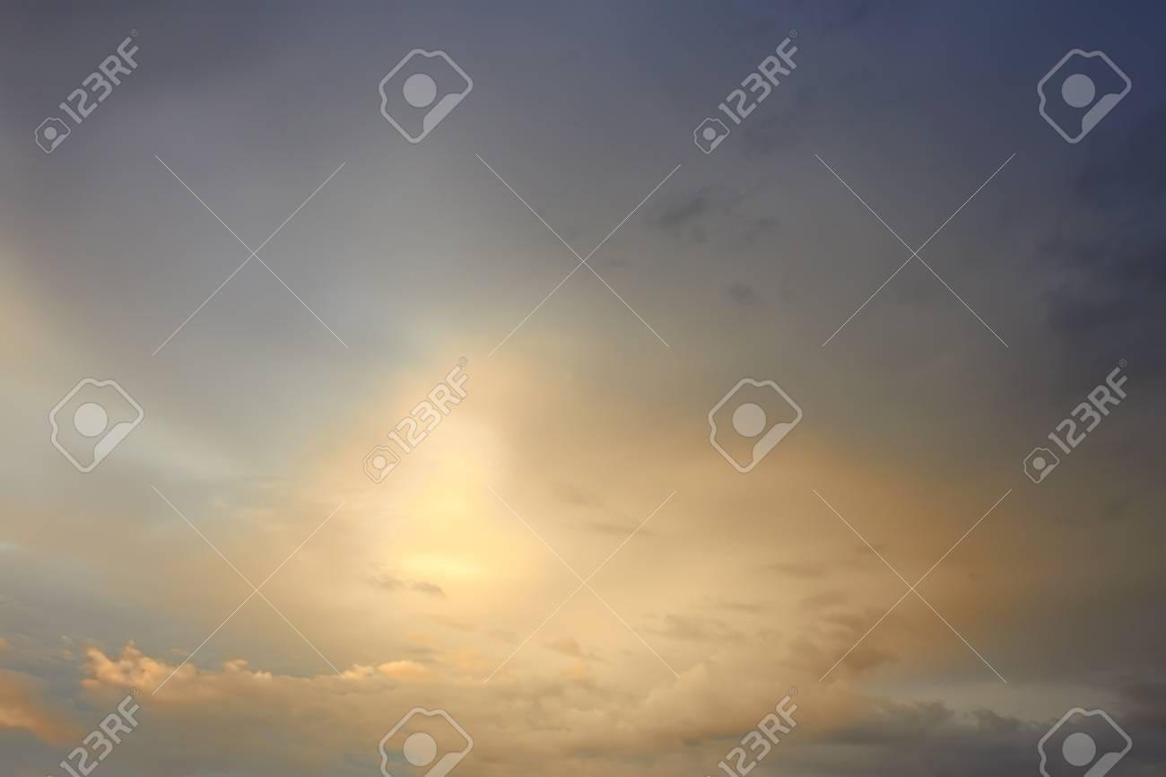 Light of evening sun breaks through the thick clouds Stock Photo - 14844974