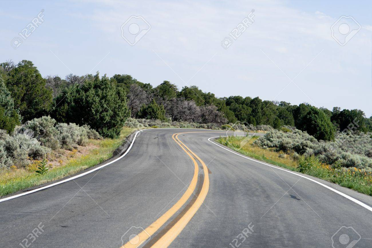 S shaped curve in a two lane highway, outside Taos, New Mexico. Stock Photo - 9273345