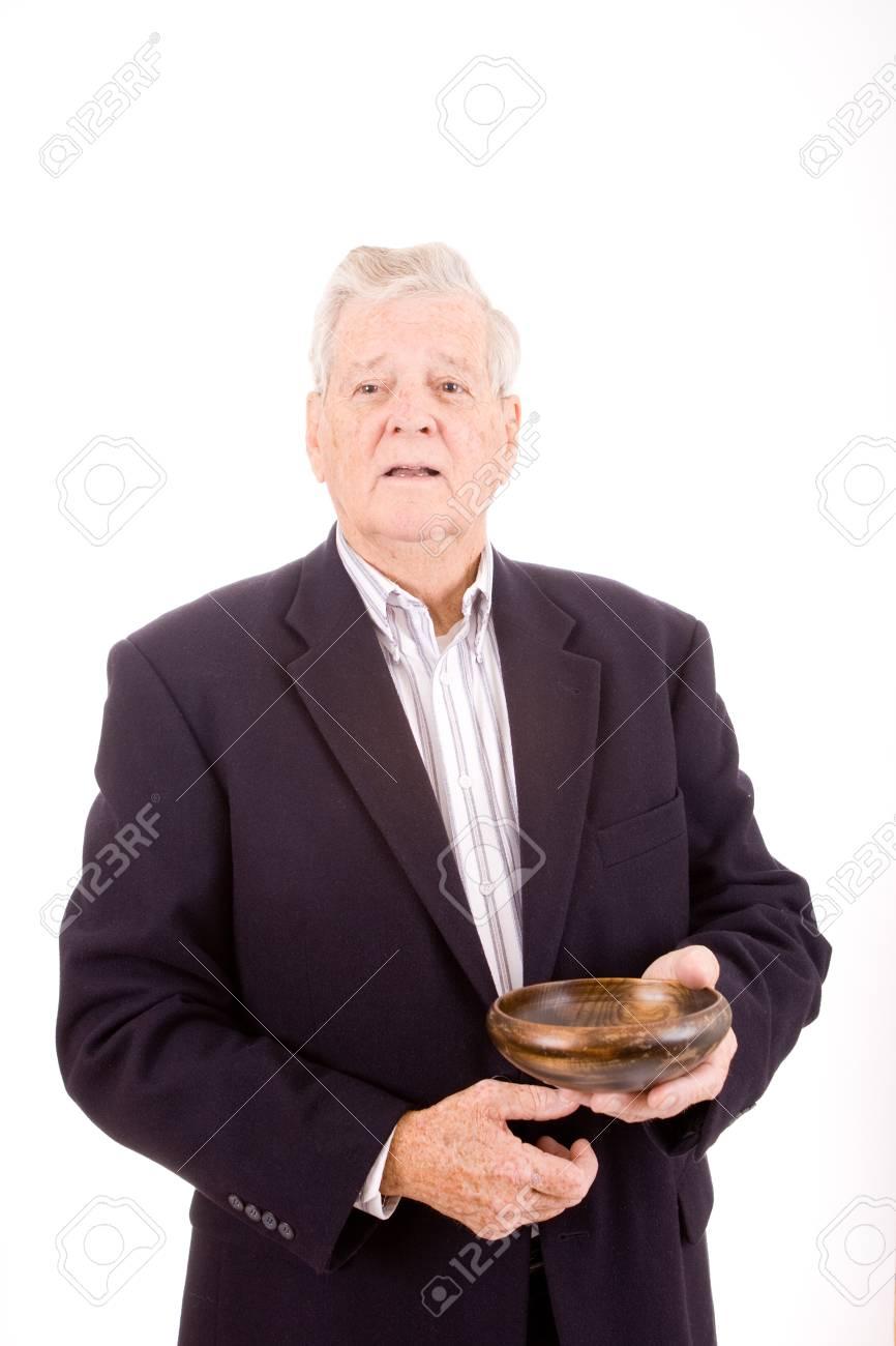 Senior man holding wood bowl. Stock Photo - 9281794
