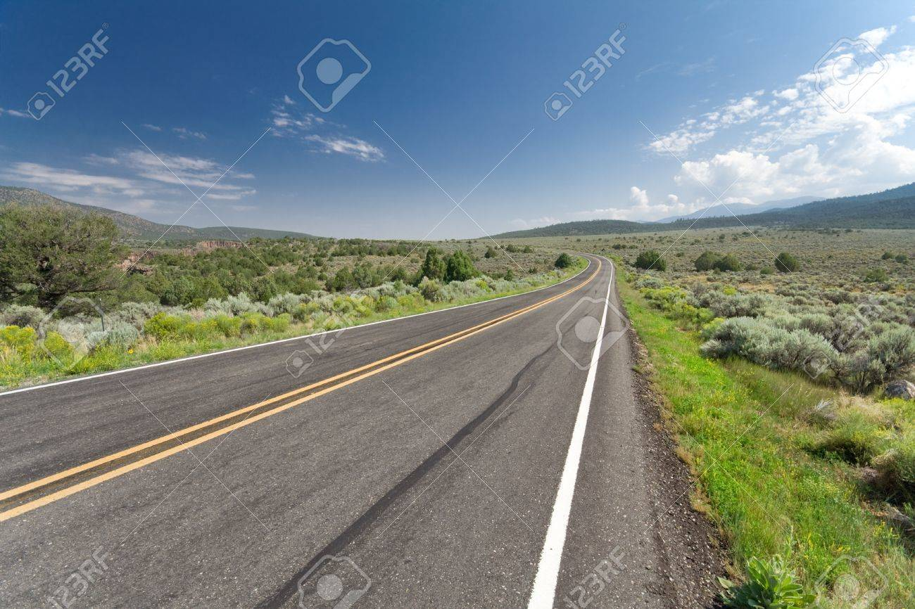 Wide angle shot of a highway outside Taos, New Mexico.  Skid mark in the foreground. Stock Photo - 10755333
