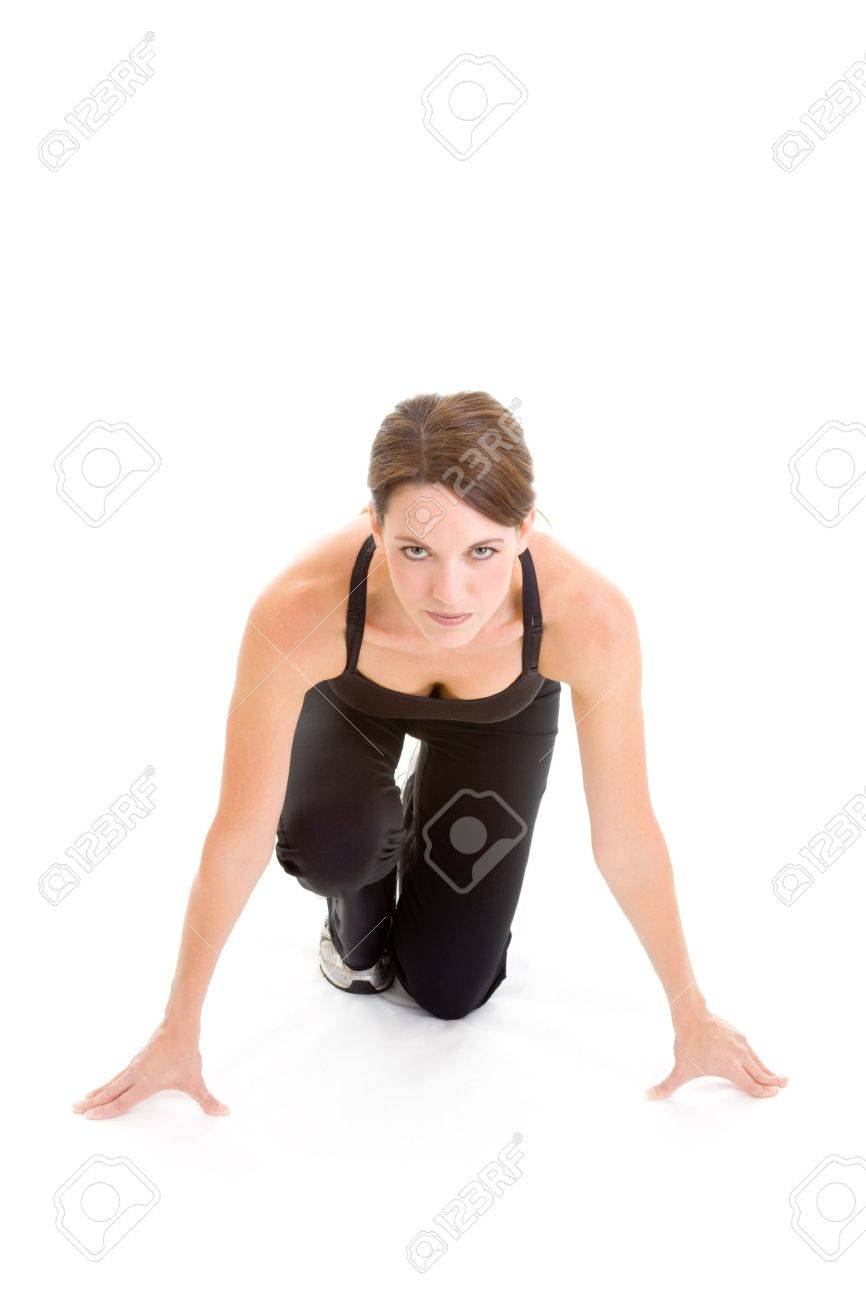 Woman in starting block position, looking at the camera, ready to sprint. Stock Photo - 10960900