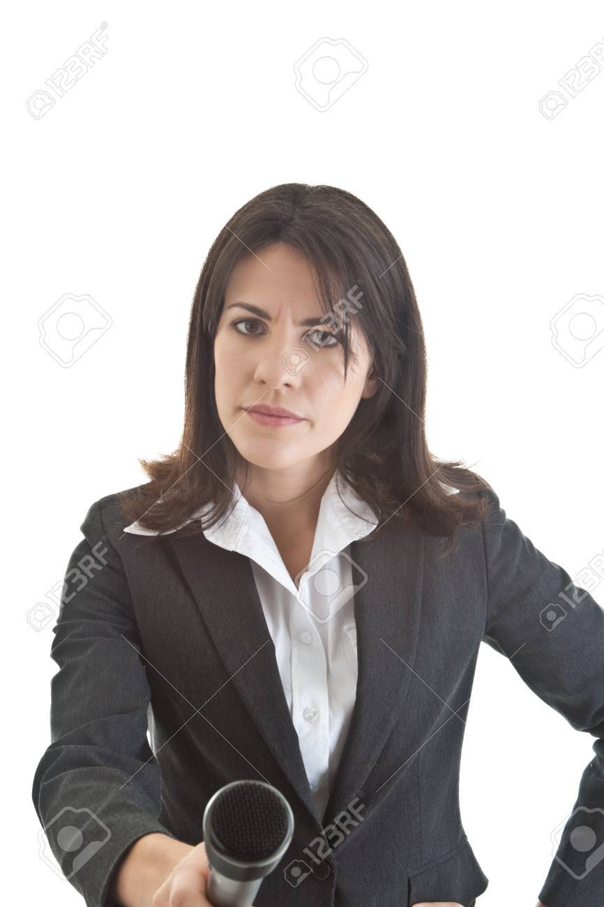 Caucasian woman with skeptical expression holding microphone to camera.  Isolated on white background. Stock Photo - 11397421