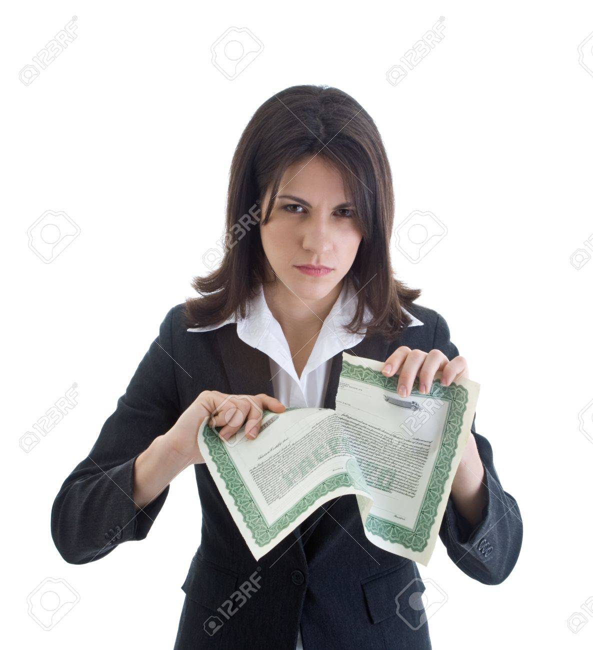 Angry Caucasian woman glaring at the camera while ripping up a stock certificate.  Isolated on white. Stock Photo - 11397268