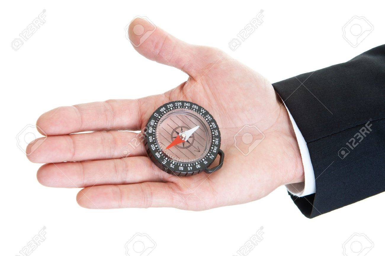 Man's hand with clear plastic compass in the palm.  Suit sleeve.  Hand is isolated on a white background Stock Photo - 11397430