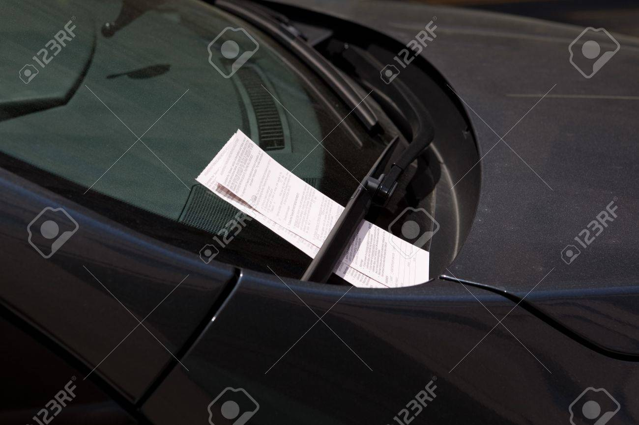 Car windshield with two parking tickets from Washington DC parking authority. Stock Photo - 11397373