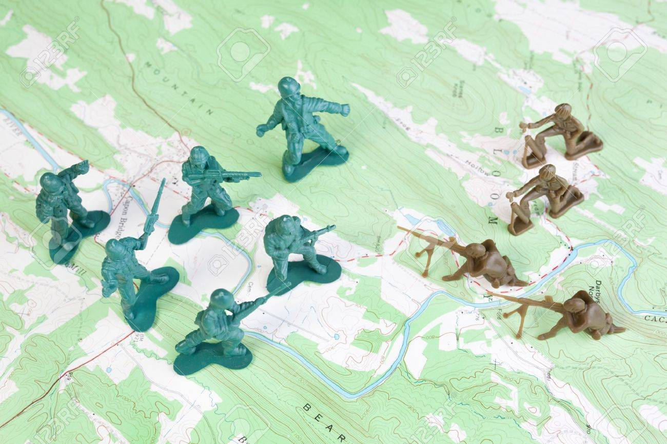 Plastic Army Men Fighting on Topographic Map. The map was produced..