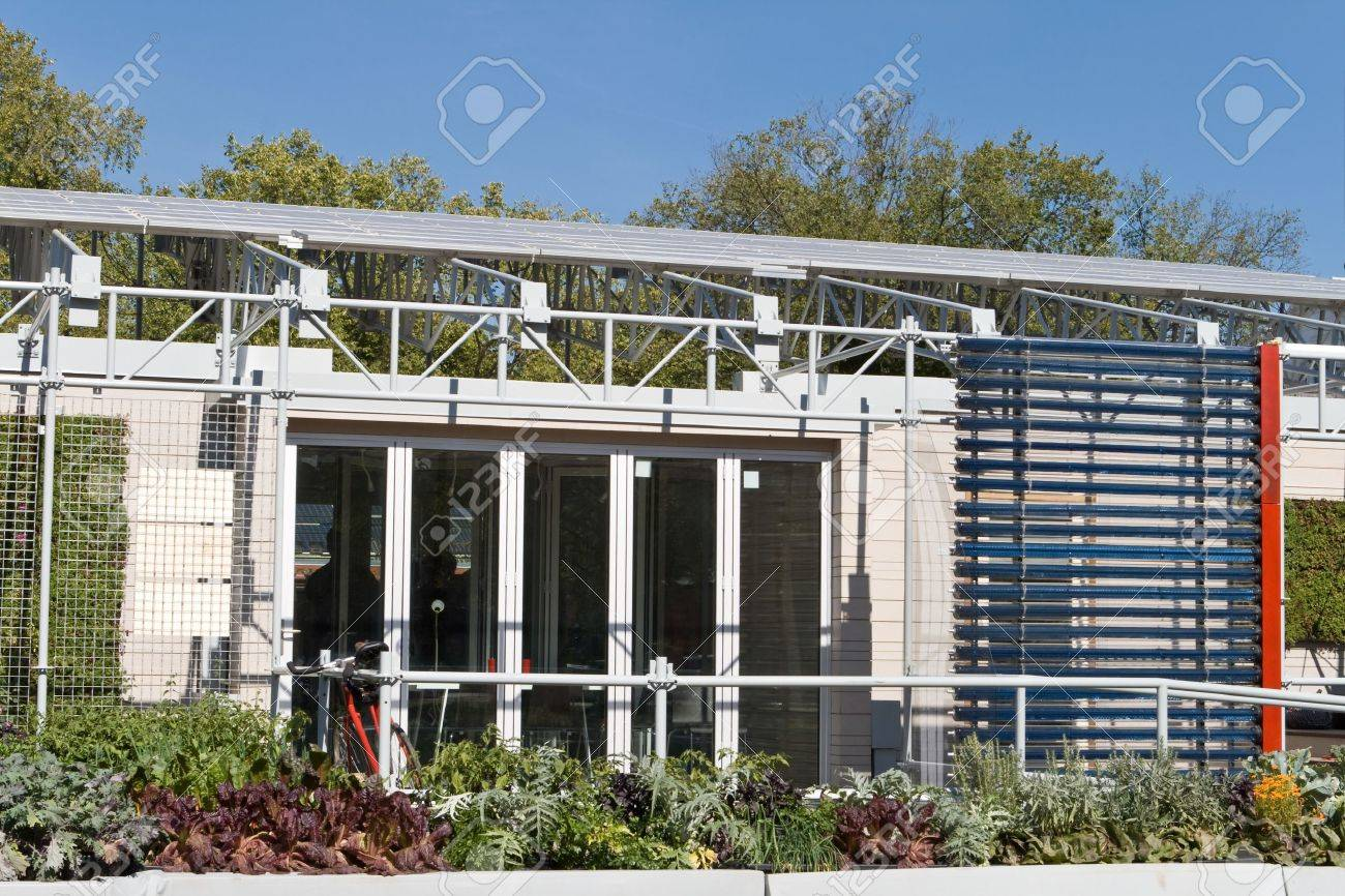 exterior of a modern solar home with pv panels on the roof and