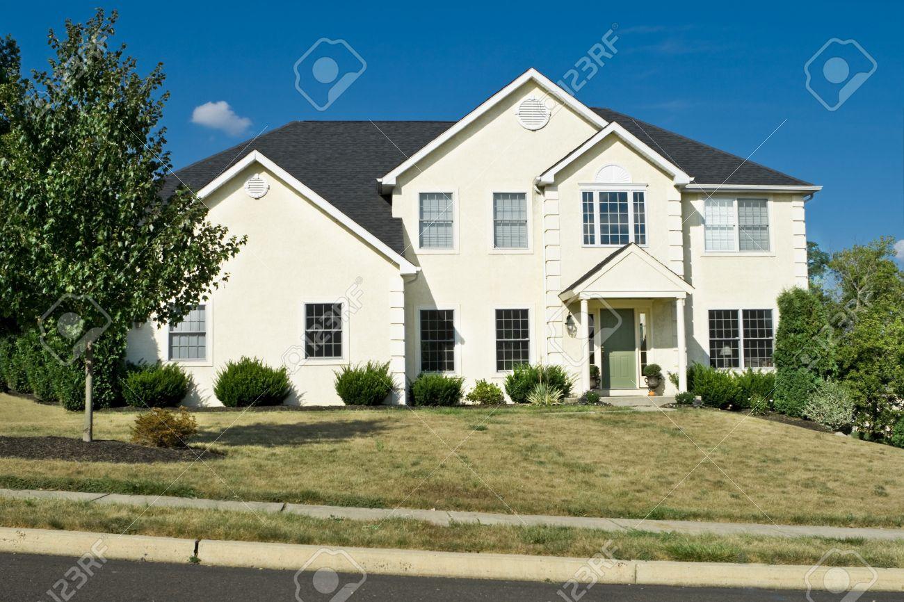 New modern single family house in suburban Philadelphia, PA.  Decorative blocks on the corners are quoins. Stock Photo - 11379578