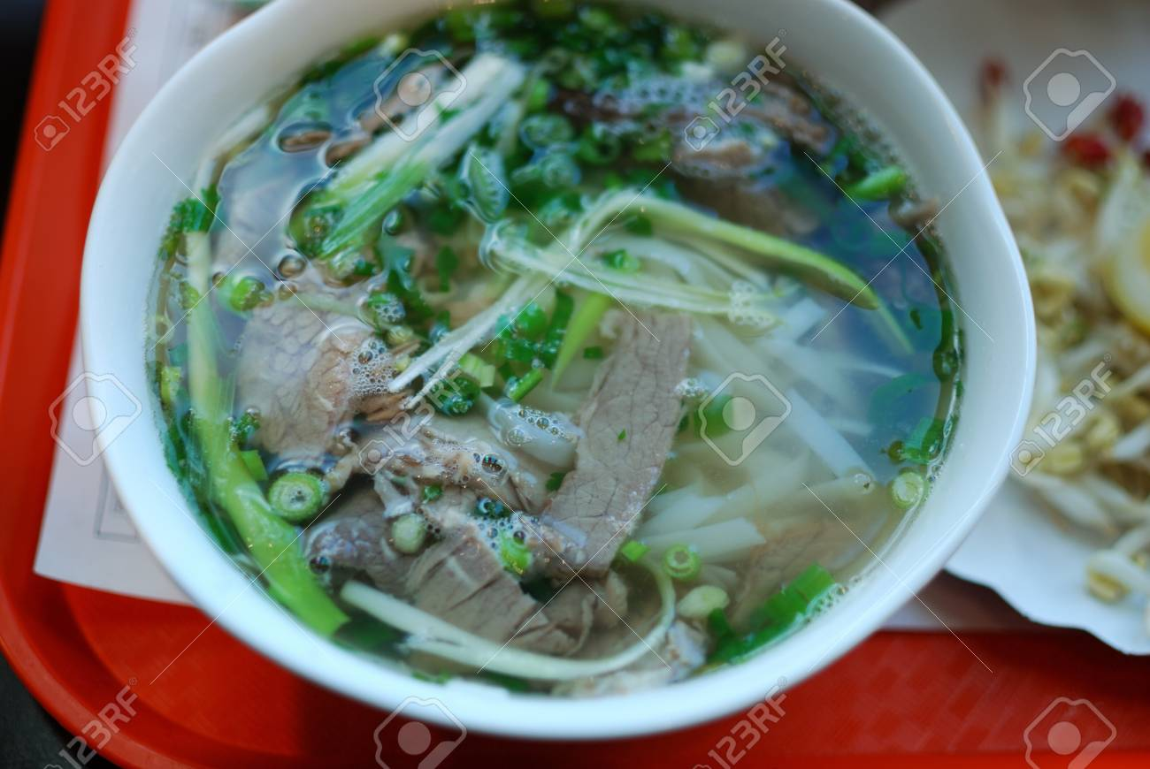 Bowl of beef pho close up look  Vietnamese traditional rice noodle