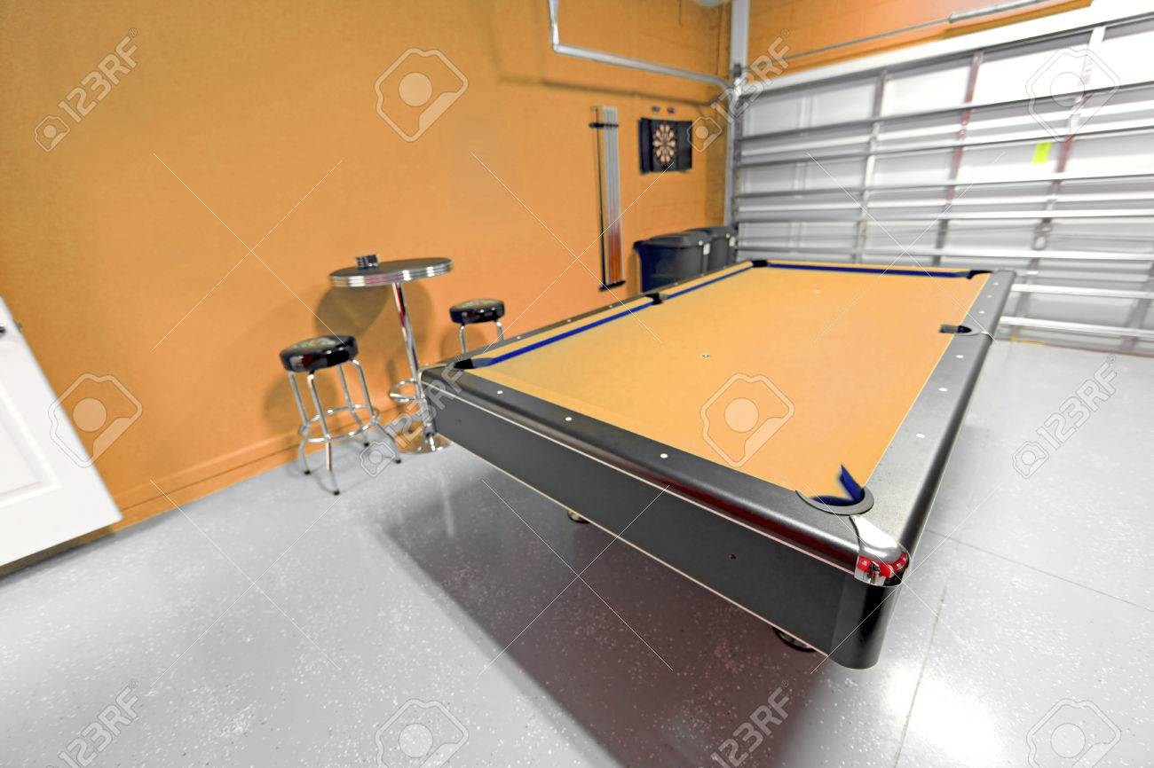 A Games Room With Pool Table In A Garage Stock Photo Picture And - Pool table in garage